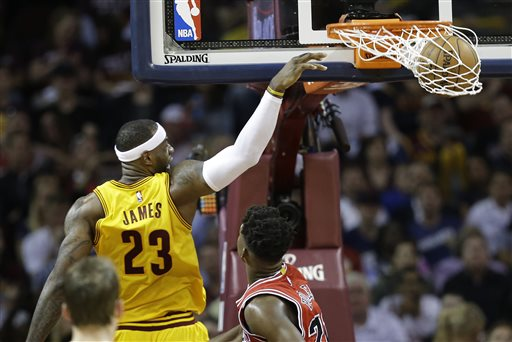 Cleveland Cavaliers forward LeBron James (23) dunks the ball against the Chicago Bulls during the first half of Game 2 in a second-round NBA basketball playoff series Wednesday, May 6, 2015, in Cleveland. (AP Photo/Tony Dejak)