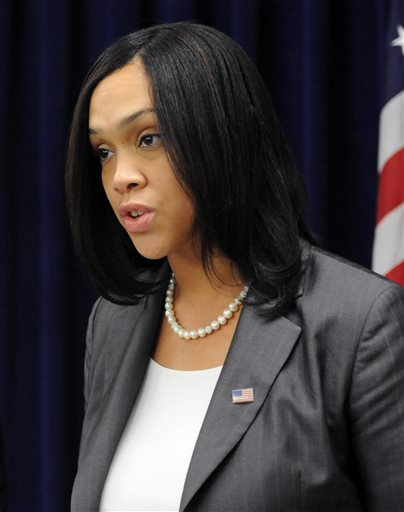 In this Feb, 6, 2015 photo, State's Attorney Marilyn Mosby speaks at a news conference, in Baltimore.  Baltimore's chief prosecutor is 35 years old, has been on the job for less than four months, and is about to take on the biggest challenge of her career  weighing the evidence against six police officers in the death of Freddie Gray and deciding whether they deserve to be criminally charged.  (Kim Hairston/The Baltimore Sun via AP)