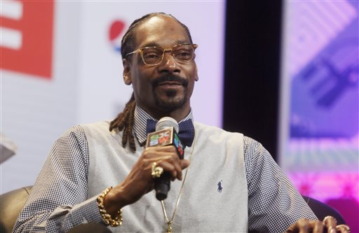 "In this March 20, 2015 file photo, rapper Snoop Dogg takes part in the ""Keynote Conversation with Snoop Dogg"" at the South by Southwest festival in Austin, Texas. Texas' chief law enforcement official called Snoop Dogg a ""dope smoking cop hater"" before reprimanding a state trooper who posed for a picture with the rapper, according to emails made public Wednesday, May 6, 2015. (Jack Plunkett/Invision via AP, File)"