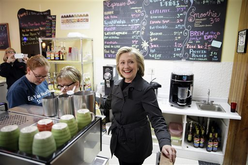 Democratic presidential candidate Hillary Rodham Clinton stops at Em's Coffee Co., Tuesday, May 19, 2015, in Independence, Iowa. (AP Photo/Charlie Neibergall)