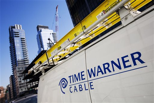 This Feb. 2, 2009 file photo shows a Time Warner Cable truck in New York .Charter Communications is close to buying Time Warner Cable for about $55 billion, two people familiar with the negotiations said Monday, May 25, 2015. (AP Photo/Mark Lennihan, File)