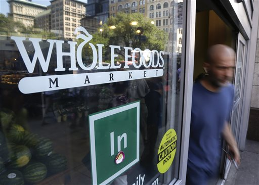 Shoppers come and go from a Whole Foods Market store in Union Square, Wednesday, June 24, 2015, in New York. New York City's consumer chief said Wednesday that Whole Foods supermarkets have been routinely overcharging customers by overstating the weight of prepackaged meat, dairy and baked goods. (AP Photo/Julie Jacobson)