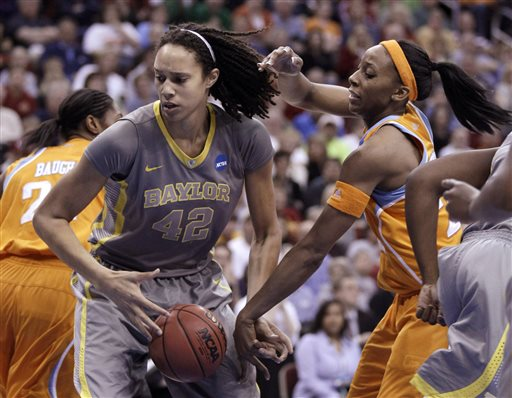 FILE - In this March, 2012, file photo, Baylor's Brittney Griner grabs a rebound in front of Tennessee's Glory Johnson during an NCAA college basketball tournament regional final in Des Moines, Iowa. Griner has filed to annul her marriage to fellow WNBA player Johnson-Griner. Griner, the 6-foot-8 Phoenix Mercury star, and Johnson-Griner, who plays for the Tulsa Shock, were married May 9. (AP Photo/Charlie Neibergall, File)