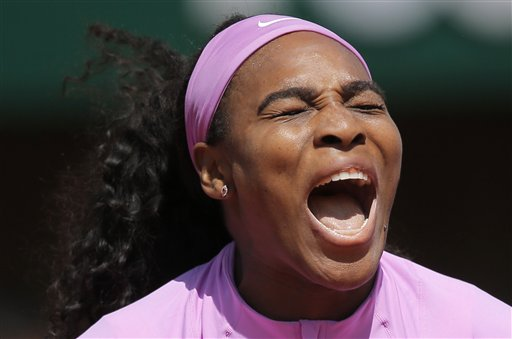 Serena Williams of the U.S. shouts as she plays compatriot Sloane Stephens of the U.S. during their fourth round match of the French Open tennis tournament at the Roland Garros stadium, Monday, June 1, 2015 in Paris.  (AP Photo/Christophe Ena)