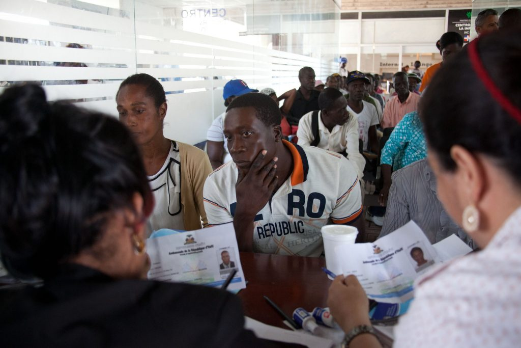 A Haitian man sought legal residency in Santo Domingo, Dominican Republic, after the government set a Wednesday deadline for worker registration. (Tatiana Fernandez/AP Photo)