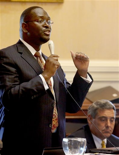 In this June 3, 2014 photo, state Sen. Clementa Pinckney speaks at the South Carolina Statehouse in Columbia, S.C. Pinckney was killed, Wednesday, June 17, 2015, in a shooting at an historic black church in Charleston, S.C. The shooter is still at large. (Grace Beahm/The Post and Courier via AP)