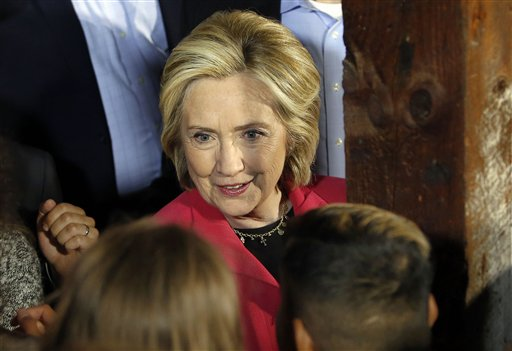 "In this June 15, 2015 file photo, Democratic presidential candidate Hillary Rodham Clinton shakes hands after speaking inside a barn as it rained in Concord, N.H. Republican Jeb Bush and Clinton are asking donors to write the checks to get their campaigns started. Yet these ""new"" candidates have been fueling their presidential ambitions for months—years, in Clinton's case—thanks to outside groups that will continue serving as big-money bank accounts throughout the race. In the 2016 presidential field, creative financing abounds. (AP Photo/Jim Cole, File)"