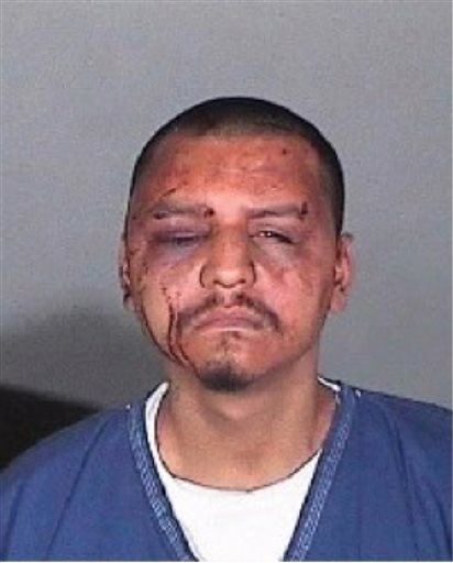 This undated evidence photo provided by the U.S. Attorney's Office shows a mug shot of Gabriel Carrillo taken by the Los Angeles County Sheriff's Department. Two Los Angeles County sheriff's deputies and a sergeant were found guilty Wednesday, June 25, 2015, in the backroom beating of Carrillo, a jail visitor who fellow guards testified already was handcuffed on the ground and covered in blood. Sgt. Eric Gonzalez and Deputy Sussie Ayala were found guilty of conspiracy to violate constitutional rights, deprivation of rights and falsification of records in the 2011 beating of Carrillo. Deputy Fernando Luviano was found guilty of deprivation of rights and falsification of records.  (U.S. Attorney's Office via AP)