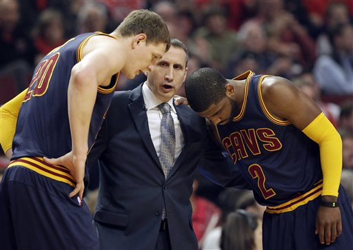 In this May 14, 2015, file photo, Cleveland Cavaliers head coach David Blatt, center, talks with Timofey Mozgov (20) and Kyrie Irving (2) during the first half of Game 6 in a second-round NBA basketball playoff series against the Chicago Bulls in Chicago. Blatt was handed a star-studded team expected to win an NBA title, but not a handbook on how to get the Cavaliers to the top. For Blatt, who left his family in Israel to pursue his dream, the journey has been difficult with speculation about his future partly undermining his success. (AP Photo/Nam Y. Huh, File)