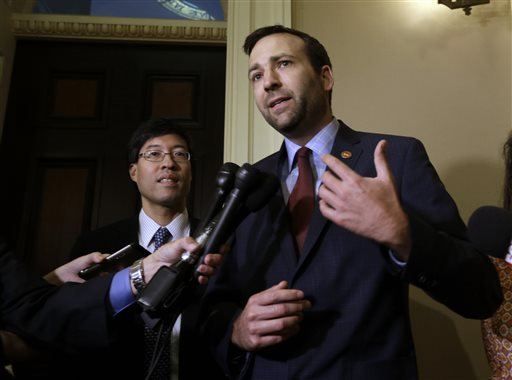 State Sen. Ben Allen, D-Santa Monica, right and Sen. Richard Pan, D-Sacramento, talk with the media after their measure requiring nearly all California school children to be vaccinated, was approved by the state Senate Monday, June 29, 2015, in Sacramento, Calif. The bill will go to the governor. (AP Photo/Rich Pedroncelli)