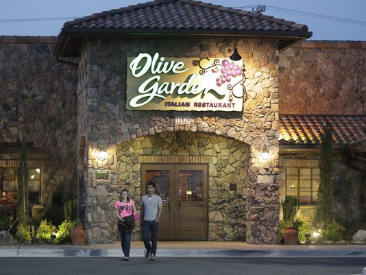 Patrons exit an Olive Garden, a Darden restaurant brand, in Short Pump, Va., May 22, 2014. (Steve Helber/AP Photo)