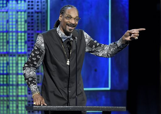 In this March 14, 2015 file photo, Snoop Dogg speaks at the Comedy Central Roast of Justin Bieber at Sony Pictures Studios in Culver City, Calif. Snoop Dogg filed a breach of contract lawsuit against Pabst Brewing Co., in Los Angeles Superior Court on Monday, June 8, 2015, seeking 10 percent of the price paid to the company last year for its Colt 45 malt beer operations. (Photo by Chris Pizzello/Invision/AP, File)