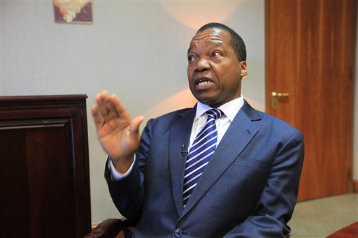 """Zimbabwe Reserve Bank Governor, John Mangudya, talks to the Associated Press in Harare, Zimbabwe, Monday, June, 15,  2015. The Zimbabwe central bank invited last week Zimbabweans still holding on to notes of the Zimbabwean dollar to  exchange them for U.S dollars starting Monday as part of a process to phase out  a currency that  has so many zero notes that ran into trillions. According to Mangudya  """"Zimbabweans are excited""""  about the move, adding that the old notes will  be burnt and shredded, """" as is the practice globally."""" (AP Photo/Tsvangirayi Mukwazhi)"""