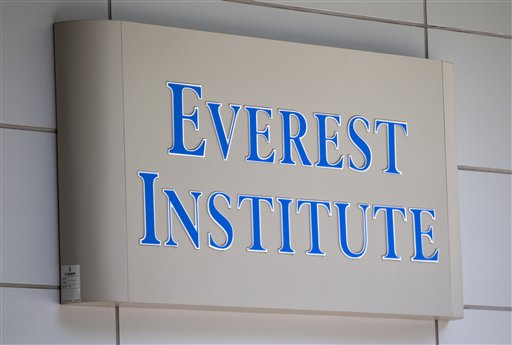 FILE - In this July 8, 2014 file photo, an Everest Institute sign is seen in a office building in Silver Spring, Md. The federal government will erase much of the debt of students who attended the now-defunct Corinthian Colleges, officials announced Monday, as part of a new plan that could cost taxpayers as much as $3.6 billion. (AP Photo/Jose Luis Magana, File)