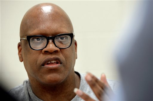 In an Tuesday, Aug. 26, 2014 file photo, Leon Brown speaks with a reporter at the Maury Correctional Institution in Maury, N.C., about his incarceration. Brown and his half-brother Henry McCollum were pardoned Thursday, June 4, 2015, by Gov. Pat McCrory in the 1983 rape and killing of a girl, clearing the way for them to each receive $750,000 in compensation from the state. McCrory's pardons for McCollum and his Brown came months after a judge vacated their convictions and ordered their release, citing new DNA evidence that points to another man killing and raping 11-year-old Sabrina Buie. (Chuck Liddy/The News & Observer via AP, File)