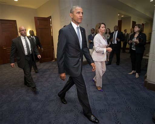 President Barack Obama and House Minority Leader Nancy Pelosi of Calif. leave meeting with House Democrats on Capitol Hill in Washington, Friday, June 12, 2015. The president made an 11th-hour appeal to dubious Democrats on Friday in a tense run-up to a House showdown on legislation to strengthen his hand in global trade talks (AP Photo/Pablo Martinez Monsivais)