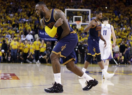 Cleveland Cavaliers forward LeBron James (23) celebrates after end of the overtime period of Game 2 of basketball's NBA Finals against the Golden State Warriors in Oakland, Calif., Sunday, June 7, 2015. The Cavaliers won 95-93 in overtime. (AP Photo/Ben Margot)