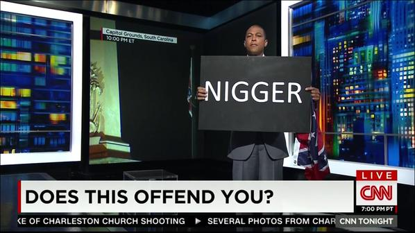 Don Lemon holding up a sign of the N-word on CNN