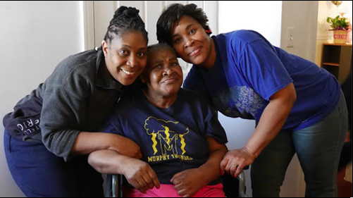 Curline Wilmoth (center) received help from Rebuilding Together Boston to make the bathroom in her Boston home more wheelchair-accessible. She is flanked by daughters Yvonne, left, and Doreen. (Sandra Larson/Bay State Banner)