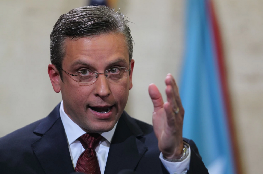 Puerto Rico Gov. Alejandro Garcia Padilla delivers his budget address for the next fiscal year at the Capitol building in San Juan on April 30. (Ricardo Arduengo/AP)