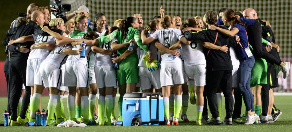 The United States team celebrates a 1-0 win over China in a quarterfinal match in the FIFA Women's World Cup soccer tournament, Friday, June 26, 2015, in Ottawa, Ontario, Canada. (Sean Kilpatrick/The Canadian Press via AP)