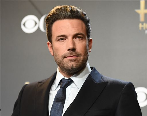 """In this Nov. 14, 2014 file photo, Ben Affleck poses in the press room with the Hollywood film award for """"Gone Girl"""" at the Hollywood Film Awards in Los Angeles. PBS says it's postponing the third season of """"Finding Your Roots"""" after an internal investigation of an episode about Ben Affleck's ancestors. In a statement Wednesday, June 24, 2015, PBS said it's also delaying a commitment to a fourth season until it's satisfied with improvement in the show's editorial standards. The public TV service launched a review after it was reported that Affleck asked the program to avoid revealing he had a slave-owning ancestor. (Photo by Jordan Strauss/Invision/AP, File)"""