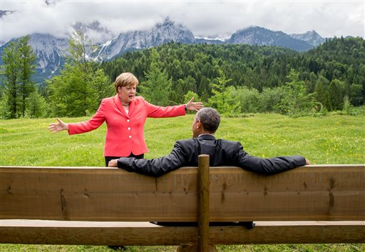 German Chancellor Angela Merkel speaks with U.S. President Barack Obama at Schloss Elmau hotel near Garmisch-Partenkirchen, Germany, Monday, June 8, 2015, during the G-7 summit. (Michael Kappeler/Pool Photo via AP)