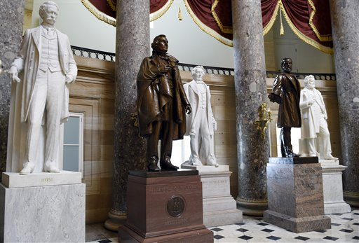 A statue of Jefferson Davis, second from left, is on display in Statuary Hall on Capitol Hill in Washington, Wednesday, June 24, 2015. The statue was given to the National Statuary Hall Collection in the U.S. Capitol by Mississippi in 1931. Davis served the nation in many positions before being appointed president of the Confederate States during the Civil War, including Secretary of War, a member of the U.S. House of Representatives and a member of the U.S. Senate.  The move in South Carolina to remove the Confederate flag from the statehouse grounds is prompting members of Congress to take a new look at Confederate images that surround them every day.  (AP Photo/Susan Walsh)