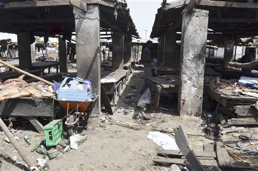A man inspects the site of  a suicide bomb attack at a market in Maiduguri , Nigeria, Tuesday, June 2, 2015.  Boko Haram attacked the northeastern Nigerian city of Maiduguri on Tuesday with deafening explosions from the west and a suicide bombing near the center that witnesses said killed as many as 20 people. (AP Photo/Jossy Ola)
