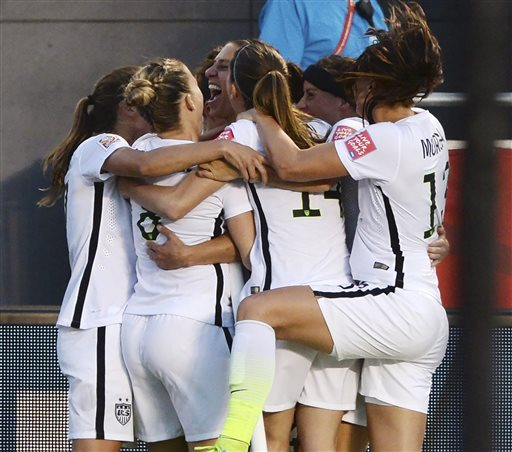 U.S. players celebrate a goal by Carli Lloyd (10) against China during the second half of a quarterfinal match in the FIFA Women's World Cup soccer tournament, Friday, June 26, 2015, in Ottawa, Ontario, Canada. (Sean Kilpatrick/The Canadian Press via AP)
