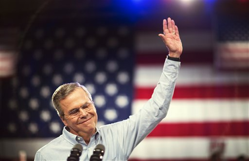 Former Florida Gov. Jeb Bush waves as he takes the stage to formally join the race for president, Monday, June 15, 2015, at Miami Dade College in Miami. (AP Photo/David Goldman)