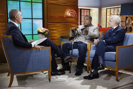 """This photo provided by NBC shows, from left, Matt Lauer, Tracy Morgan, and Benedict Morelli appearing on NBC News' """"Today"""" show on Monday, June 1, 2015 , in New York. The actor-comedian Morgan said Monday he doesn't remember anything about the limo accident that left him in a coma for two weeks, and said that, a year later, he still has bad days as well as good. Appearing live on the """"Today"""" show for his first public appearance since the accident, Morgan sat clutching a cane and became emotional as he recalled learning after the crash June 7, 2014, that his fellow comedian, James """"Jimmy Mack"""" McNair, was killed. (Peter Kramer/NBC via AP)"""