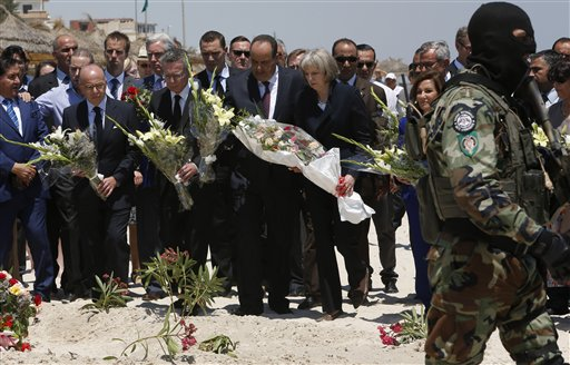 British Home Secretary Theresa May centre right, French Interior Minister Bernard Cazeneuve 2nd left, German Interior Minister Thomas de Maiziere 3rd left  joined their Tunisian counterpart  Mohamed Najem Gharsalli centre, on the beach in front of the Imperial Marhaba hotel in the Mediterranean resort of Sousse for a tribute in Sousse, Tunisa, Monday, June 29, 2015. The top security officials of Britain, France, Germany and Belgium are paying homage to the  people killed in the terrorist  attack on Friday. (AP Photo/Abdeljalil Bounhar)
