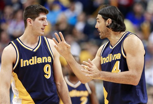 In this Feb. 22, 2015, file photo, Indiana Pacers forwards Damjan Rudez (9) and Luis Scola talk during a break in play against the Golden State Warriors in the second half of an NBA basketball game. Rudez is impressed with the growth he's seeing in European basketball. Recently, the Croatian native who attended a Basketball Without Borders camp more than a decade ago returned to his home country to work with another batch of potential stars and couldn't believe the changes. (AP Photo/R Brent Smith, File)