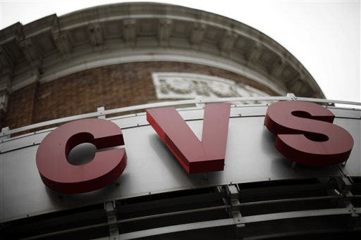 This June 20, 2011 photo shows signage at a CVS store in Philadelphia. CVS drugstores that quit tobacco sales last year are now getting health and beauty makeovers to attract customers who want more than a prescription refill, the nation's second-largest drugstore chain said Wednesday, June 17, 2015. (AP Photo/Matt Rourke, File)