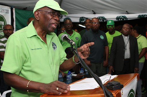 """Former FIFA vice president Jack Warner speaks at a political rally in Marabella, Trinidad and Tobago, Wednesday, June 3, 2015. Warner made a televised address Wednesday night, saying he will prove a link between soccer's governing body and his nation's elections in 2010. Warner also said in the address, which was a paid political advertisement, that """"I reasonably actually fear for my life."""" (AP Photo/Anthony Harris)"""