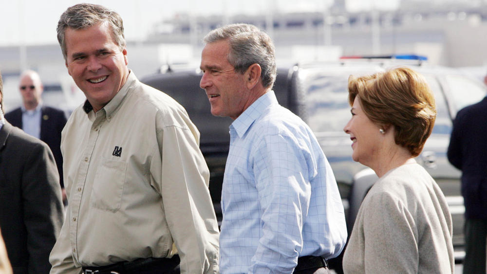 Then-Florida Gov. Jeb Bush welcomes President George W. Bush and First Lady Laura Bush to Fort Lauderdale in 2004. (Pablo Martinez Monsivais/AP Photo)