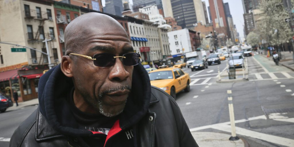 Jonathan Fleming, who was exonerated of murder after almost 25 years behind bars, on his way to get is first bankcard on Friday April 18, 2014 in New York. (AP Photo/Bebeto Matthews)