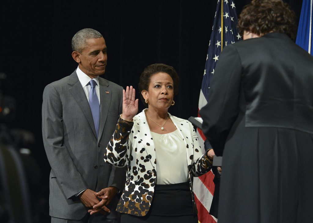 Loretta Lynch being sworn in by Associate Supreme Court Justice Sonia Sotomayor as President Obama looks on. (Freddie Allen/NNPA Photo)
