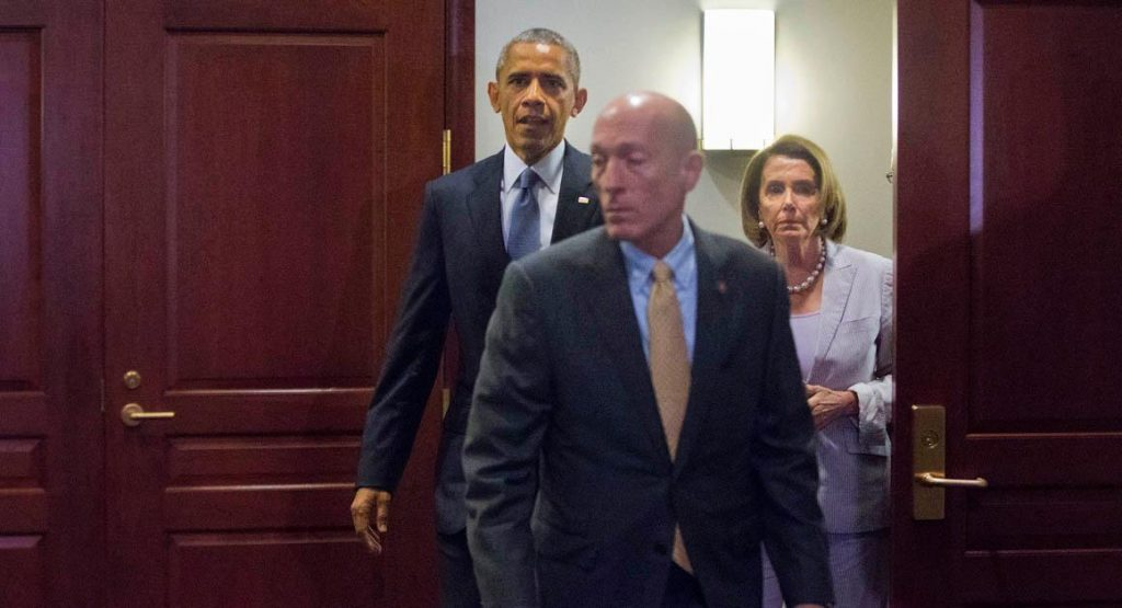President Barack Obama walks out with House Minority Leader Nancy Pelosi of Calif., after meeting with House Democrats on Capitol Hill in Washington, Friday, June 12, 2015. The president made an 11th-hour appeal to dubious Democrats on Friday in a tense run-up to a House showdown on legislation to strengthen his hand in global trade talks. (AP Photo/Pablo Martinez Monsivais)