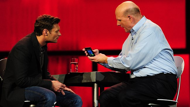 Microsoft CEO Steve Ballmer chats with co-host Ryan Seacrest about staying on message. (AP Photo)
