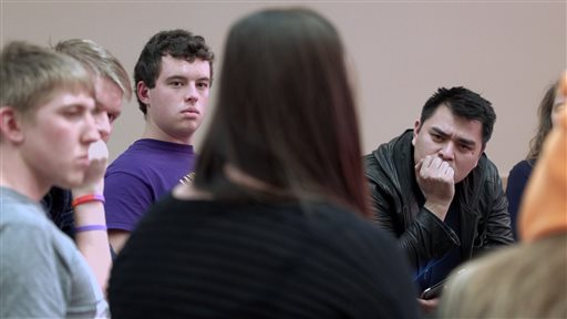 "In this image released by MTV, filmmaker Jose Antonio Vargas, right, listens to a group of young people during the filming of his documentary ""White People."" The full film debuts Wednesday, July 22, at 8 p.m. ET/PT, offered simultaneously online. (MTV via AP)"