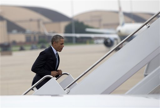 President Barack Obama runs up the stairs to board Air Force One, Thursday, July 2, 2015, at Andrews Air Force Base, Md., en route to La Crosse, Wis., where he is to speak  at the University of Wisconsin at La Crosse about economy and to promote a proposed Labor Department rule that would make more workers eligible for overtime. (AP Photo/Carolyn Kaster)