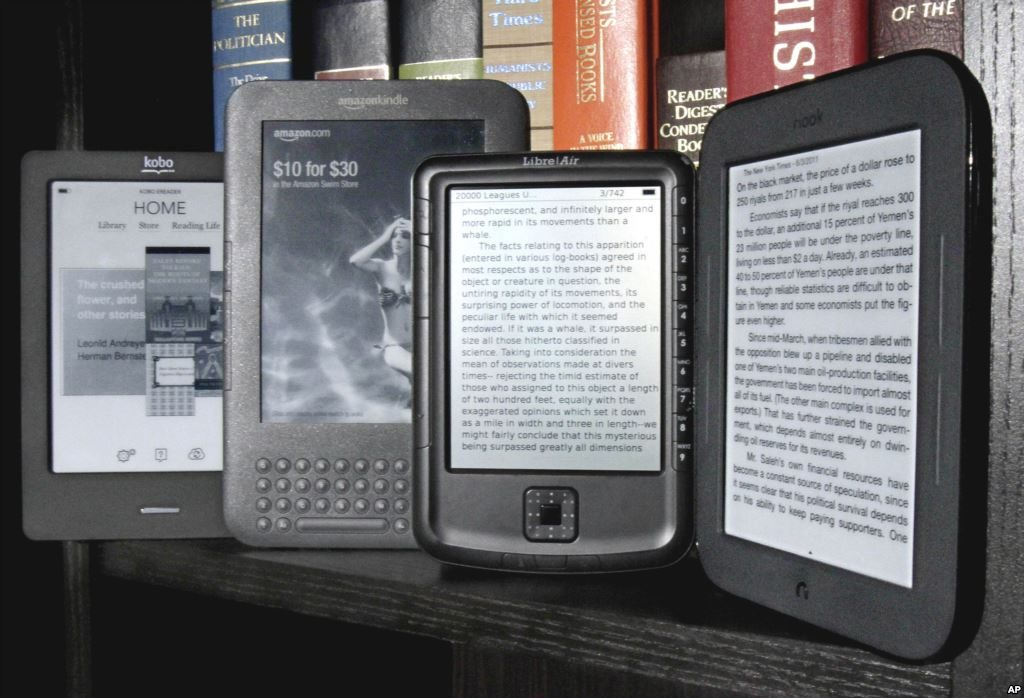 The Kobo eReader Touch, an Amazon Kindle, an Aluratek Libre Air, and a Barnes & Noble Nook, left to right, are displayed in this photo, in New York, Tuesday, June 14, 2011. Today, e-book readers, including a Kindle, can be purchased for just over $100. (AP Photo/Richard Drew)