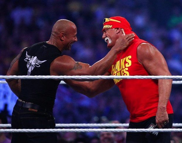 The Rock embraces Hulk Hogan at WrestleMania 30 in 2013. (WWE)
