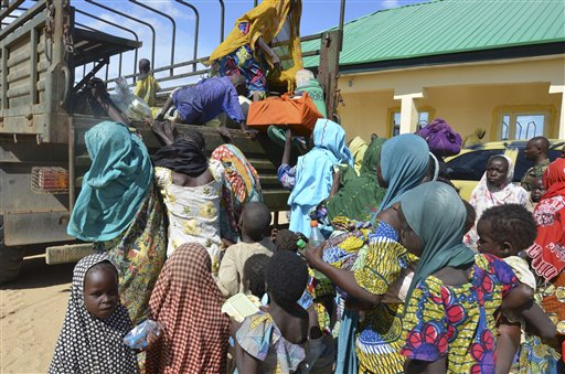 Women and children rescued by Nigerian soldiers from Boko Haram extremists in northeast Nigeria arrive at the military office in Maiduguri, Nigeria, Thursday, July 30, 2015. Soldiers rescued 71 people, almost all girls and women, in firefights that killed many Boko Haram militants in villages near the northeastern city of Maiduguri, Nigeria's military said Thursday. (AP Photo/Jossy Ola)