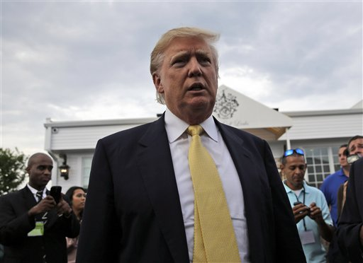 Republican presidential candidate Donald Trump arrives at a fundraising event at a golf course in the Bronx borough of New York, Monday, July 6, 2015. (AP Photo/Seth Wenig)