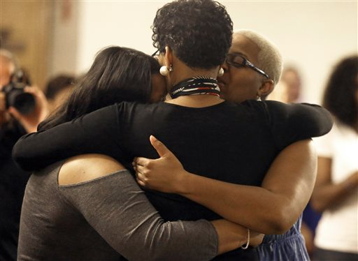 Geneva Reed-Veal, center, hugs family members at a memorial service for her daughter Sandra Bland at Prairie View A&M University, Tuesday, July 21, 2015, in Prairie View, Texas. A newly released dashcam video documents how a routine traffic stop escalated into a shouting confrontation between a Texas state trooper and Bland, which led to her arrest. Bland was found hanging in her jail cell three days after the incident. (AP Photo/Pat Sullivan)