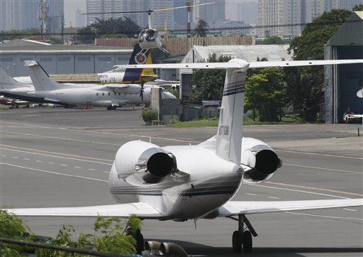A Gulf Stream private jet chartered by Grammy award-winning singer Chris Brown, sits at the end of a taxiway housing private hangars of the Manila Domestic Airport at suburban Pasay city, south of Manila, Philippines Thursday, July 23, 2015. Chris Brown, who performed at a packed concert Tuesday night, was barred from leaving the country following fraud allegations against him and his promoter for a canceled concert last New Year's Eve in the Philippines. (AP Photo/Bullit Marquez)