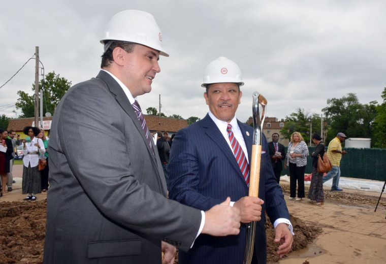 Michael McMillan, president and CEO of the Urban League of Metropolitan St. Louis, wielded a shovel alongside Marc Morial, president and CEO of the National Urban League, at the groundbreaking for a new community center at the site of the burnt-out QuikTrip in Ferguson. (Wiley Price/St. Louis American)